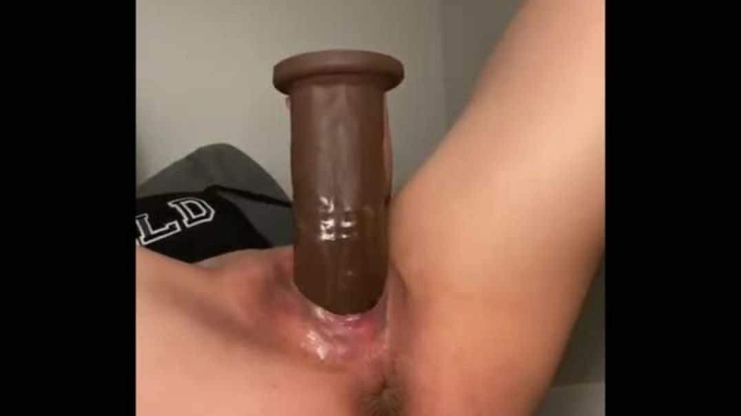 Pushing a huge dildo out of her stretched pussy
